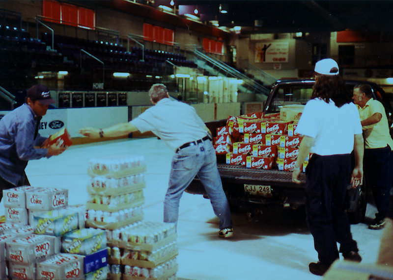 "Hundreds of pounds of supplies were delivered to Gander to feed, clothe, and comfort its 7,000 temporary residents. The food was stored in Gander's hockey rink or, as Mayor Claude Elliott dubbed it, ""the world's largest walk-in refrigerator."".png"